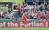 Portland, Oregon - Saturday July 2, 2016: Portland Thorns FC midfielder Dagny Brynjarsdottir (11) reacts after scoring a goal during a regular season National Women's Soccer League (NWSL) match at Providence Park.