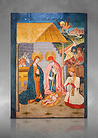 Gothic altarpiece ofthe Nativity from the workshop of Taller de Pere Garcia de Benavarri, circa 1475, tempera and gold leaf on for wood, from the church of Nostra Senyora de Baldos de Montanyana, Osca.  National Museum of Catalan Art, Barcelona, Spain, inv no: MNAC   114750-1. Against a grey art background.