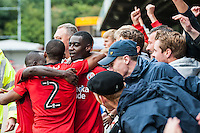 Enzio Boldewijn (center) of Crawley Town (7) Celebrates scoring his sides second goal and match winner with fans and his team   during the Sky Bet League 2 match between Crawley Town and Luton Town at the Broadfield/Checkatrade.com Stadium, Crawley, England on 17 September 2016. Photo by Edward Thomas / PRiME Media Images.