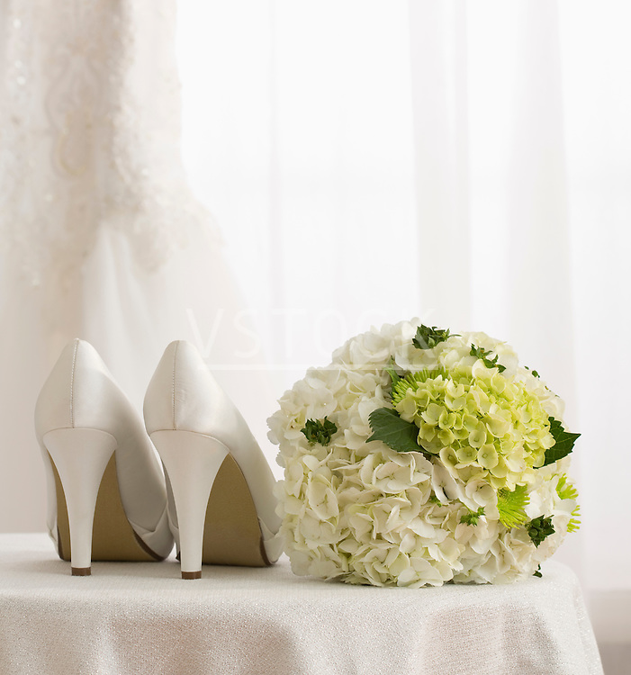 White dress shoes and bouquet