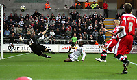 ATTENTION SPORTS PICTURE DESK<br /> Pictured: Nathan Dyer of Swansea (C) shootrs the ball above the crossbar of goalkeeper Rob Elliot of Charlton (L) from a cross by Jason Scotland (not pictured)<br /> Re: Coca Cola Championship, Swansea City FC v Charlton Athletic at the Liberty Stadium, Swansea, south Wales. 28 February 2009<br /> Picture by D Legakis Photography / Athena Picture Agency, Swansea 07815441513