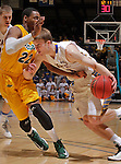 SIOUX FALLS, SD - MARCH 12:  Nate Wolters #3 of South Dakota State drives toward Kory Brown #22 of North Dakota State during their championship game at the 2013 Summit League Tournament at the Sioux Falls Arena. (Photo by Dick Carlson/Inertia)