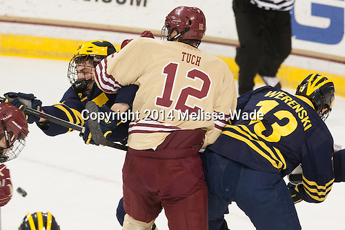 Kevin Lohan (Michigan - 24), Alex Tuch (BC - 12), Zach Werenski (Michigan - 13) - The Boston College Eagles defeated the visiting University of Michigan Wolverines 5-1 (EN) on Saturday, December 13, 2014, at Kelley Rink in Conte Forum in Chestnut Hill, Massachusetts.