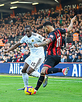 Joshua King of AFC Bournemouth looks to cross the ball under pressure from Willy Boly of Wolverhampton Wanderers during AFC Bournemouth vs Wolverhampton Wanderers, Premier League Football at the Vitality Stadium on 23rd February 2019