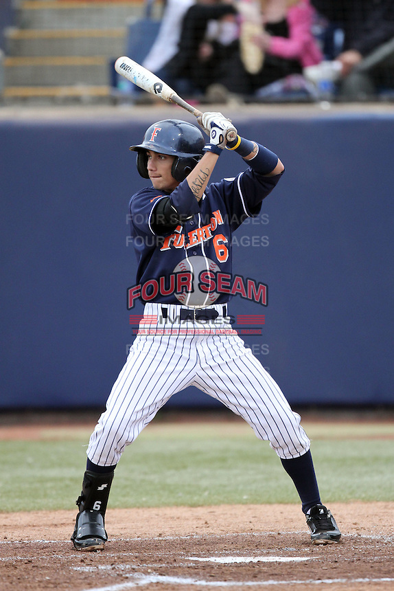 Richie Pedroza #6 of the Cal. St. Fullerton Titans bats against the Cal. St. Long Beach 49'ers at Goodwin Field in Fullerton,California on May 14, 2011. Photo by Larry Goren/Four Seam Images