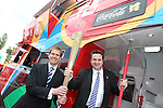 Coca-Cola Enterprises (Wales) Regional Director Mark Dewhurst with Huw Lewis AM, Minister for Housing, Heritage & Regeneration holding the 2012 Olympic Torch after officially opening the Gemau Cymru...Leckwith Stadium.08.07.11.©Steve Pope