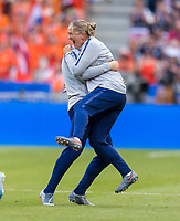 LYON,  - JULY 7: Graeme Abel and Dawn Scott celebrate during a game between Netherlands and USWNT at Stade de Lyon on July 7, 2019 in Lyon, France.