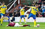 Hearts v St Johnstone....06.05.12   SPL.Chris Millar jumps a tackle by Ian Black.Picture by Graeme Hart..Copyright Perthshire Picture Agency.Tel: 01738 623350  Mobile: 07990 594431