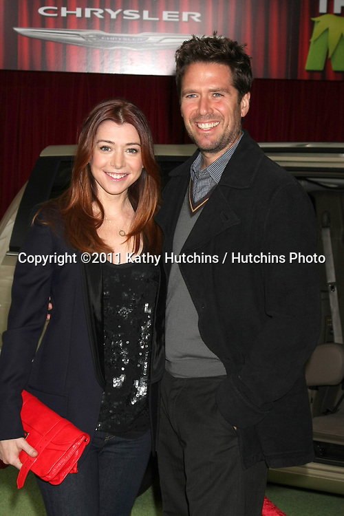 "LOS ANGELES - NOV 12:  Alyson Hannigan; Alexis Denisof arrives at the ""Muppets"" World Premiere at El Capitan Theater on November 12, 2011 in Los Angeles, CA"