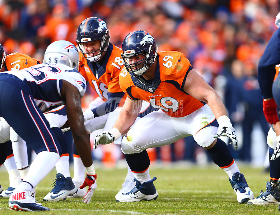Jan 24, 2016; Denver, CO, USA; Denver Broncos guard Evan Mathis (69) blocks for quarterback Peyton Manning (18) against the New England Patriots in the AFC Championship football game at Sports Authority Field at Mile High. The Broncos defeated the Patriots 20-18 to advance to the Super Bowl. Mandatory Credit: Mark J. Rebilas-USA TODAY Sports