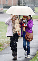 From left, Iris Young, 11 and Vanessa Gonzalez as they carry their dolls to a tea party covered from snow by an umbrella at the Mercer Museum Saturday, April 9, 2016 in Doylestown, Pennsylvania.  (Photo by William Thomas Cain)
