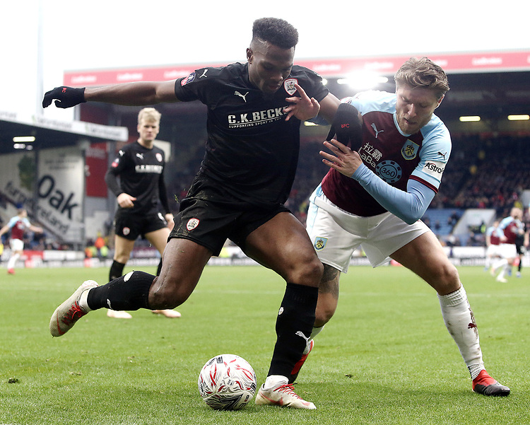 Barnsley's Dimitri Cavare shields the ball from Burnley's Jeff Hendrick<br /> <br /> Photographer Rich Linley/CameraSport<br /> <br /> Emirates FA Cup Third Round - Burnley v Barnsley - Saturday 5th January 2019 - Turf Moor - Burnley<br />  <br /> World Copyright © 2019 CameraSport. All rights reserved. 43 Linden Ave. Countesthorpe. Leicester. England. LE8 5PG - Tel: +44 (0) 116 277 4147 - admin@camerasport.com - www.camerasport.com