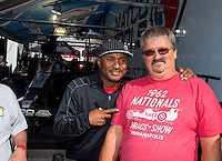 Jun. 1, 2014; Englishtown, NJ, USA; NHRA top fuel driver Antron Brown (left) poses for a photo with a fan during the Summernationals at Raceway Park. Mandatory Credit: Mark J. Rebilas-