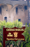 A view of the ruined chateau, the Pope's summer palace over the vineyards. A sign to Chateau Maucoil  Chateauneuf-du-Pape Châteauneuf, Vaucluse, Provence, France, Europe