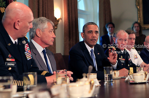 President Barack Obama meets with Chairman Martin Dempsey and service secretaries,service chiefs, and senior enlisted advisors to discuss sexual assault in the military, (left toright General Ray Odierno, Secretary of Defense Chuck Hagel, President Obama, Chairman Martin Dempsey, Vice Chief of Naval Operations Admiral Mark Ferguson)..Credit: Dennis Brack / Pool via CNP