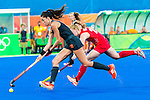 Naomi van As #18 of Netherlands carries the ball while Lily Owsley #26 of Great Britain covers during Netherlands vs Great Britain in the gold medal final at the Rio 2016 Olympics at the Olympic Hockey Centre in Rio de Janeiro, Brazil.