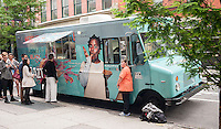 "Fans of the Netflix series ""Orange is the New Black"" line up at a rebranded food truck in Soho in New York for free ""Crazy Pyes"" and chocolate and vanilla swirl soft ice cream on Thursday, June 12, 2014. The promotion is for the Netflix only series and references the character Suzanne ""Crazy Eyes"" Warren whose catchphrase is ""I threw my pie for you"". The show is currently in its second season. (© Richard B. Levine)"
