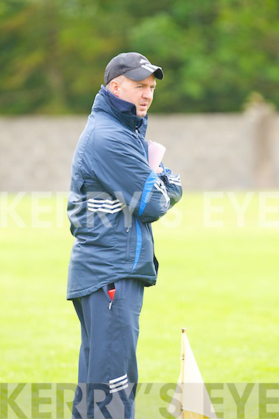 Castleisland Desmond's trainer Martin Horgan watches his players against Listowel Emmets last Sunday afternoon in Listowel.