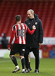 Kieron Freeman of Sheffield Utd is welcomed off the pitch by  Alan Knill assistant manager during the English League One match at Bramall Lane Stadium, Sheffield. Picture date: December 31st, 2016. Pic Simon Bellis/Sportimage