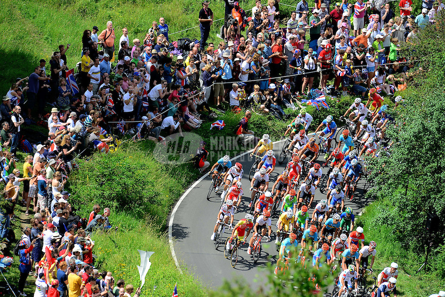 Jul 28, 2012; Dorking, United Kingdom; The peleton of riders race around Butterfly Bend at Box Hill during the mens cycling race. Mandatory Credit: Mark J. Rebilas-USA TODAY Sports