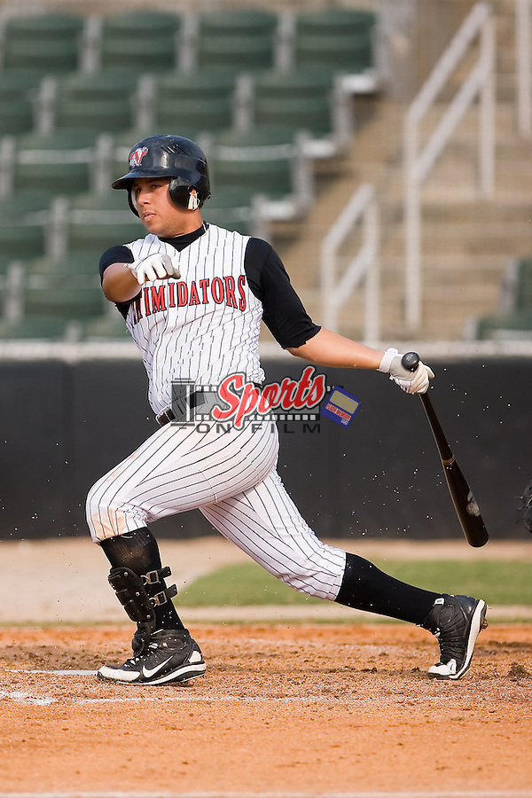 Sergio Miranda (8) of the Kannapolis Intimidators follows through on his swing at Fieldcrest Cannon Stadium in Kannapolis, NC, Sunday June 22, 2008.