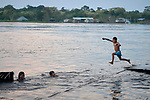 A boy jumps into the Javari River at Atalaia do Norte in Brazil's Amazon region.