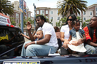 SAN FRANCISCO - JULY 10:  Vladimir Guerrero of the Los Angeles Angels rides in the All Star Game Red Carpet Show with his family before the All Star Game against the National League at AT&T Park in San Francisco, California on July 10, 2007.  Photo by Brad Mangin