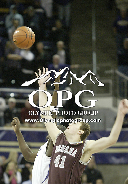 28 December 2008:  Montana's #41 Brian Qvale tips the ball to a teammate during the opening tip off against the Washington Huskies at the Bank of America Arena at Hec Edmundson Pavilion in Seattle, WA.  Washington won 75-53 over Montana.