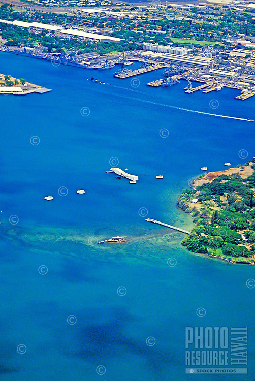 Vertical aerial shot of Pearl Harbor with the  Arizona Memorial in the center of photo.