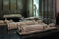 Effigy of Charles V, 1338-80, king of France 1364-80 who commissioned his own funerary sculpture from Andre Beauneveu in 1364, and his wife Jeanne de Bourbon, 1338-77, holding a bag indicating that only the entrails of the deceased are buried here, originally from the Eglise des Celestins in Paris and moved to Saint-Denis in 1816, in the Basilique Saint-Denis, Paris, France. Behind is Louis de Sancerre, 1342-1402, Constable of France 1397-1402, commissioned by Charles VI, 15th century, in marble. The basilica is a large medieval 12th century Gothic abbey church and burial site of French kings from 10th - 18th centuries. Picture by Manuel Cohen