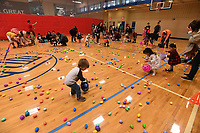 NWA Democrat-Gazette/J.T. WAMPLER  Children collect  Easter Eggs Sunday March 25, 2018 during the annual Donald W. Reynolds Boys and Girls Club Easter at the Club event. Children got to scoop up 16,000 eggs and there was face painting and carnival games. The event was moved inside due to rainy weather.