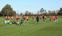 Pictured: Players warming up. Wednesday 05 November 2014<br /> Re: Swansea City FC players training at Fairwood training ground, ahead of their Premier League game against Arsenal on Sunday.