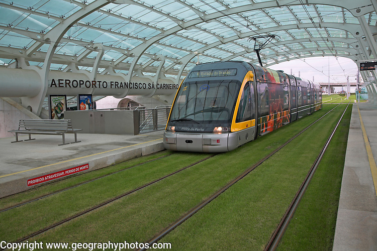 Metro train on grass tracks Oporto airport station, Porto, Portugal