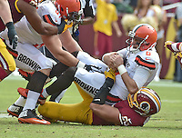Cleveland Browns quarterback Cody Kessler (6) is sacked by Washington Redskins defensive end Trent Murphy (93) in second quarter action against the Washington Redskins at FedEx Field in Landover, Maryland on October 2, 2016.<br /> Credit: Ron Sachs / CNP /MediaPunch ***EDITORIAL USE ONLY***