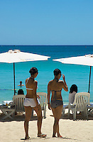 Girls walking at the famous white beach onBORACAY ISLAND PHILIPPINES