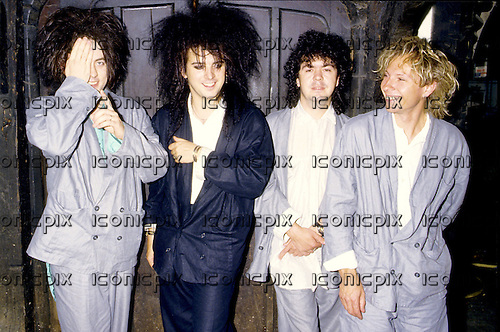 "The Cure -  L-R: Robert Smith, Simon Gallup, Lol Tolhurst, Boris Williams.- photosession to promote the release of their album ""The Head On The Door"" - London UIK - 30 Aug 1985.  Photo credit: George Chin/IconicPix"