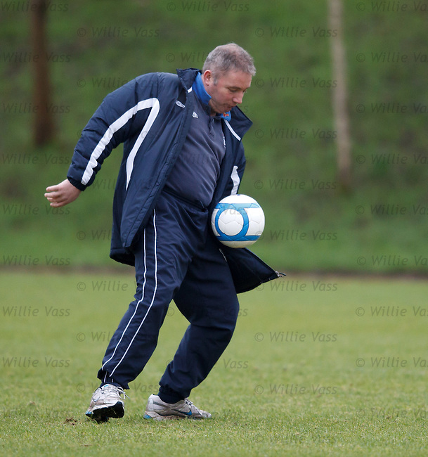 Ally McCoist chests the ball down and shoots it past Allan McGregor in goals