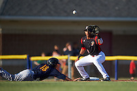 Batavia Muckdogs first baseman Kris Goodman (8) waits for a throw as Tommy Edman (16) dives back to the bag during a game against the State College Spikes on June 24, 2016 at Dwyer Stadium in Batavia, New York.  State College defeated Batavia 10-3.  (Mike Janes/Four Seam Images)
