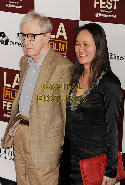 "Woody Allen, Soon-Yi Previn.""To Rome With Love"" Los Angeles Film Festival North American Premiere held at Regal Cinemas LA Live, Los Angeles, California, USA..June 14th, 2012.half length brown suit blue shirt glasses black dress red clutch bag married husband wife .CAP/ROT/TM.© TM/Roth/Capital Pictures"