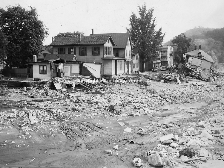 Third Street in Seymour washed out by the 1955 flood. The building to the left faced Bank Street. Many of the houses here were washed down the river. 19 August 1955.