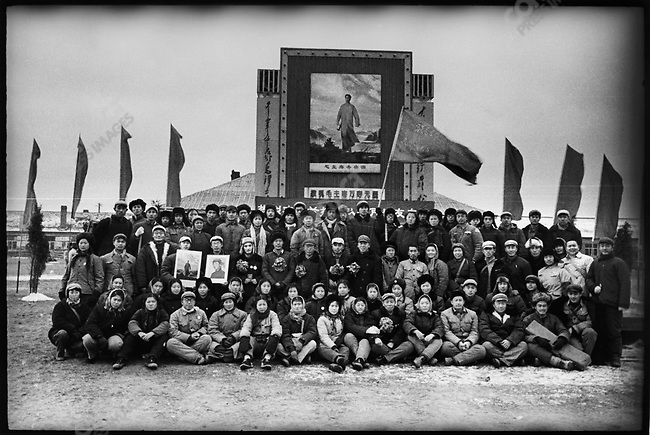 """Soldiers"" from the Liuhe May 7th Cadre School pose for a group picture in front of a famed painting depicting Mao's trip to Anyuan in Hunan province. Mao had first achieved national prominence by his coordination of a miner's strike at Anyuan in 1922. Qingan county, 15 December 1969"