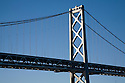 The westernmost suspension tower on the West Span of the San Francisco Bay Bridge rises into a clear blue sky. The Bay Bridge, connecting San Francsico and Oakland, is a major transportation route. The West Span has undergone major seismic retrofit work in recent years, while the East Span is being completely rebuilt.