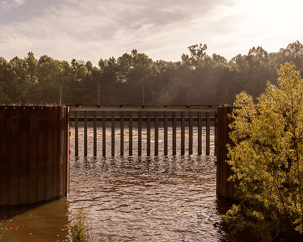 May 5, 2018. Riegelwood, North Carolina.<br /> <br /> The Cape Fear River at Lock and Dam #1. Lock and Dam #1, located about 30 miles north of the Wilmington and 50 miles south of the Chemours plant, is where the city's intake pipes for their drinking water are.<br /> <br /> The Chemours Company, a spin off from DuPont, manufactures many chemicals at its plant in Fayetteville, NC. One of these, commonly referred to as GenX, is part of the process of teflon manufacturing. Chemours has been accused of dumping large quantities of GenX into the Cape Fear River and polluting the water supply of city's down river and allowing GenX to leak into local aquifers.