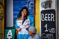 Urban Street Photograph of a beautiful señorita taken in Puerto Vallarta, Mexico.