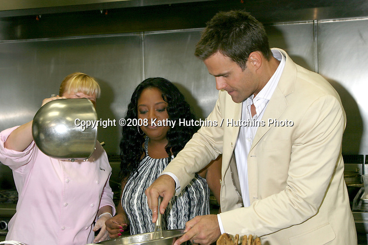 Sherri Shepherd & Cameron Mathison in the Wolfgang Puck Catering kitchen demonstrating and trying the deserts for the Daytime Emmy dinner (adjacent to the Kodak Theater piror to  Daytime Emmys) at the Kodak Theater in  Hollywood, CA.June 19, 2008.©2008 Kathy Hutchins / Hutchins Photo .