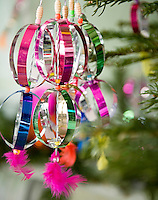 Close-up of colourful baubles hanging on a Christmas tree