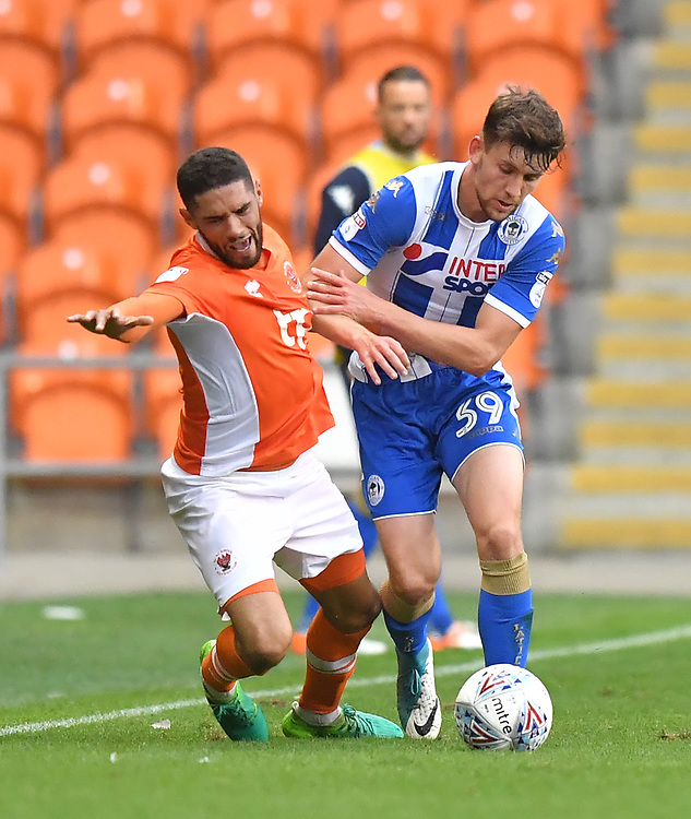 Blackpool's Kelvin Mellor is fouled by Wigan Athletic's Callum Lang<br /> <br /> Photographer Dave Howarth/CameraSport<br /> <br /> The EFL Checkatrade Trophy - Blackpool v Wigan Athletic - Tuesday 29th August 2017 - Bloomfield Road - Blackpool<br />  <br /> World Copyright &copy; 2018 CameraSport. All rights reserved. 43 Linden Ave. Countesthorpe. Leicester. England. LE8 5PG - Tel: +44 (0) 116 277 4147 - admin@camerasport.com - www.camerasport.com
