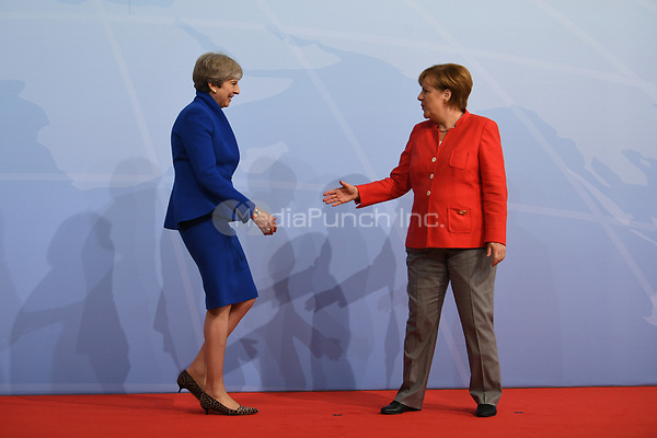 German chancellor Angela Merkel greets Theresa May, the prime minister of the UK, at the G20 summit in Hamburg, Germany, 7 July 2017. The heads of the governments of the G20 group of countries are meeting in Hamburg on the 7-8 July 2017. Photo: Bernd Von Jutrczenka/dpa-pool/dpa /MediaPunch ***FOR USA ONLY***