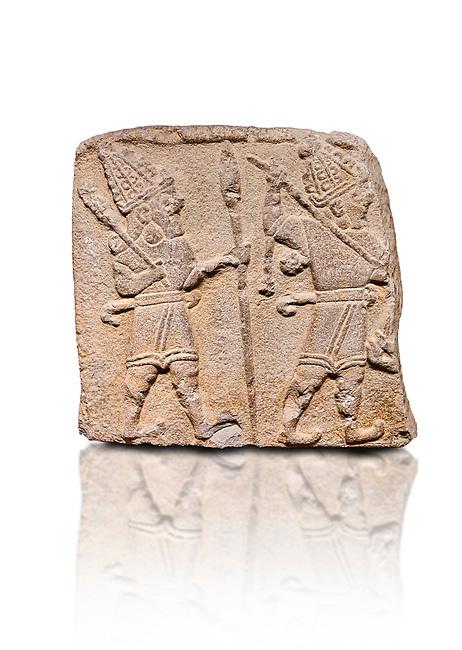 Aslantepe Hittite relief sculpted orthostat stone panel. Limestone, Aslantepe, Malatya, 1200-700 B.C. Anatolian Civilizations Museum, Ankara, Turkey. Scene of two Gods walking one carrying a spear, dressed in tunics.<br /> <br /> Anatolian Civilizations Museum, Ankara, Turkey