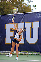 18 March 2012:  FIU's Nina Djordjevic serves the ball during her singles match against Colubmia's Tiana Takenaga as the Columbia Lions defeated the FIU Golden Panthers, 5-2, at University Park in Miami, Florida.